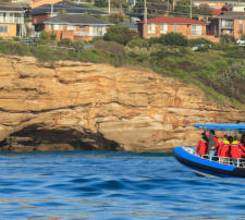 Coastal sightseeing boat near Caves Beach